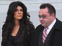 Teresa Giudice and Joe Giudice are seen outside a federal criminal court, where they face mortgage and bankruptcy fraud charges on March 4, 2014 in Newark, New Jersey.