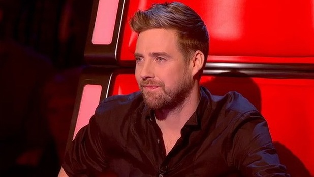 Ricky Wilson watches Jade Mayjean Peters perform