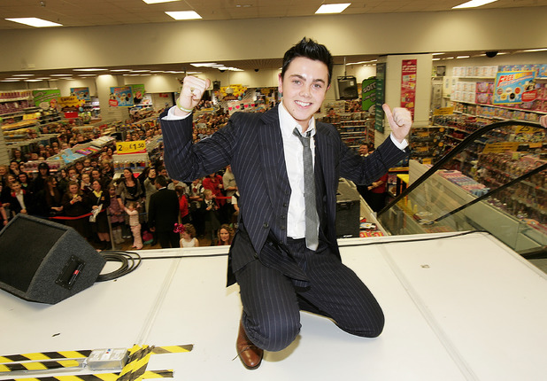 LIVERPOOL, UNITED KINGDOM - MARCH 12: 'X Factor' finalist Ray Quinn attends an instore signing as part of a one-day tour of the UK to promote his eponymously titled debut album, released today, at Woolworths on March 12, 2007 in Liverpool, England. Ray is due to perform tonight at the Cardiff date of the 'X Factor' Tour. (Photo by Dave Hogan/Getty Images)