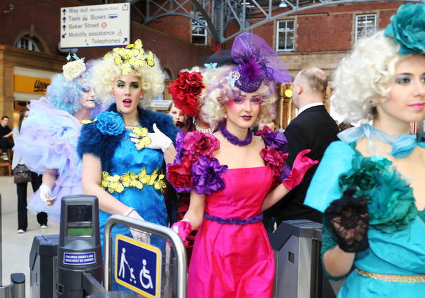 Hunger Games fans congregate at Marylebone Station for Effie Trinket flashmob