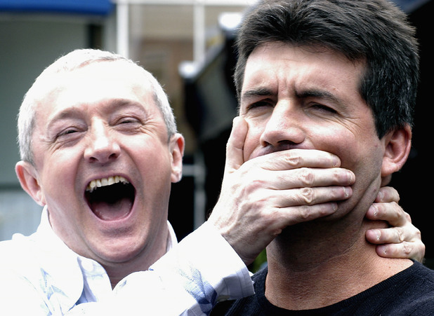 DUBLIN, IRELAND - JULY 6: Louis Walsh and Simon Cowell pose for photos after auditioning hundreds of hopeful musicians for their new TV show 'X Factor' on Julr6, 2004 at Jury's Hotel, Dublin, Ireland. (Photo by ShowBizIreland/Getty Images)