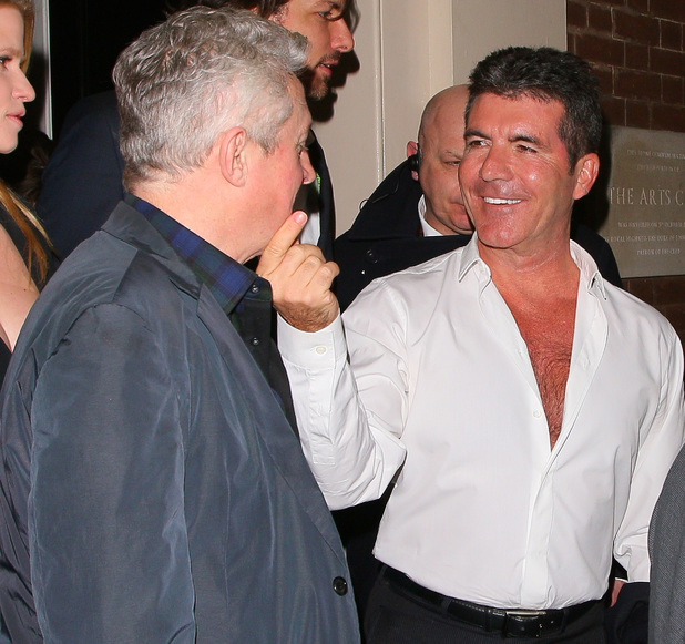 LONDON, UNITED KINGDOM - MARCH 11: Louis Walsh and Simon Cowell at the Arts club on March 11, 2014 in London, England. (Photo by Mark Robert Milan/FilmMagic)
