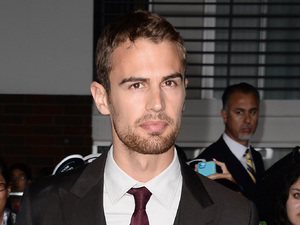 LOS ANGELES, CA - MARCH 18: Actor Theo James arrives at the premiere of Summit Entertainment's 'Divergent' at the Regency Bruin Theatre on March 18, 2014 in Los Angeles, California. (Photo by Frazer Harrison/Getty Images)
