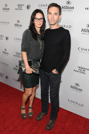 BEVERLY HILLS, CA - MARCH 17: Actress Courteney Cox and recording artist Johnny McDaid arrive at the 2014 Tribeca Film Festival LA Kickoff Reception at The Beverly Hilton Hotel on March 17, 2014 in Beverly Hills, California. (Photo by Angela Weiss/Getty Images for Tribeca Film Festival)
