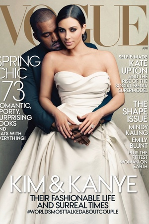 Kanye West and Kim Kardashian pose together on the cover of US Vogue.
