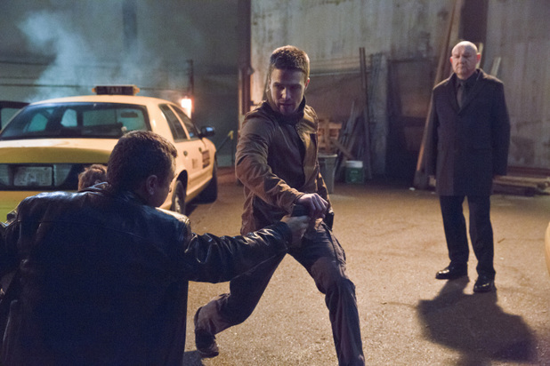 Stephen Amell as Oliver Queen and Eugene Lipinski as Alexei Leonov in 'Arrow' S02E16: 'Suicide Squad'