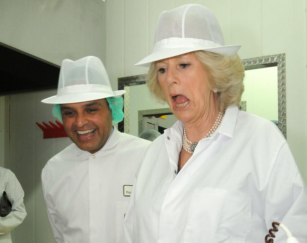 The Duchess of Cornwall talks to workers during a visit to the Duchy Desserts factory in Launceston, Cornwall. Picture date: Tuesday, March 15, 2011. See PA story ROYAL Camilla. Photo credit should read: Wayne Perry/The Sun/NPA solo rota/PA Wire