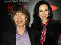 Band cancel tour after death of L'Wren Scott, long-time partner of frontman Mick Jagger.