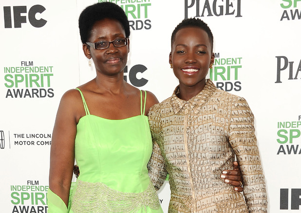 SANTA MONICA, CA - MARCH 01: Actress Lupita Nyong'o (R) and mother Dorothy Nyong'o attend the 2014 Film Independent Spirit Awards on March 1, 2014 in Santa Monica, California. (Photo by Jason LaVeris/FilmMagic)