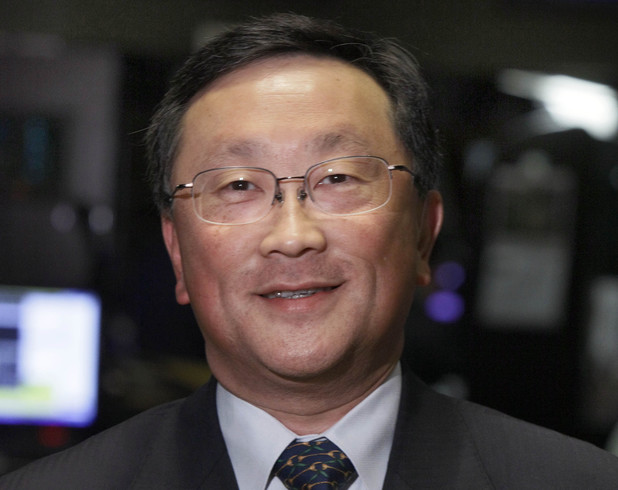 John Chen poses for a photo on the floor of the New York Stock Exchange