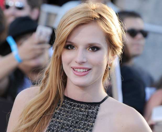 Bella Thorne arrives at the Los Angeles premiere of 'Divergent' at Regency Bruin Theatre on March 18, 2014 in Los Angeles, California.