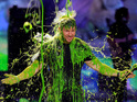 Pharrell Williams and host Mark Wahlberg get slimed at Nickelodeon awards night.