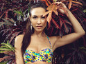 The former I'm a Celebrity star models her new swimwear range.