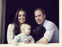 The young royal family are pictured at a window in Kensington Palace.