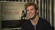 The Quiet Ones star Sam Claflin discusses working with Stef Dawson (Annie Cresta) on The Hunger Games: Mockingjay and if his life has changed since Catching Fire's release.