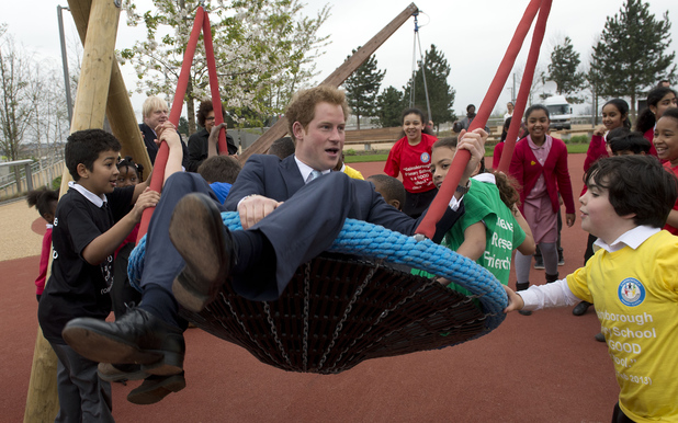 Caption:LONDON, ENGLAND - APRIL 04: HRH Prince Harry explores a new playground with a group of children from Gainsborough Primary school in Newham during an official visit to Queen Elizabeth Olympic Park with the Mayor of London, Boris Johnson on April 4, 2014 in London, England The park will open to the public on Saturday 5th April. (Photo by Chris Harris - WPA Pool /Getty Images)