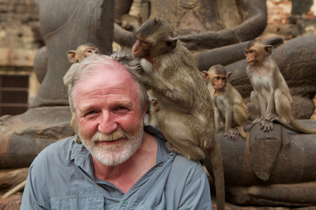 Dr George McGavin with macaques on Monkey Planet