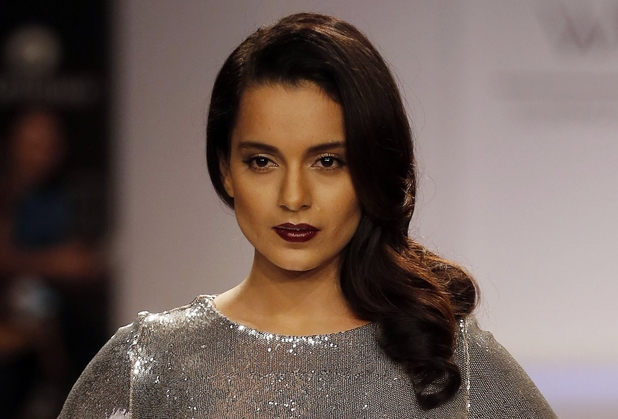Kangana Ranaut walks the runway to showcase a creation by Dorothy Perkins during the Lakme Fashion Week in Mumbai, India, Thursday, March 13, 2013.