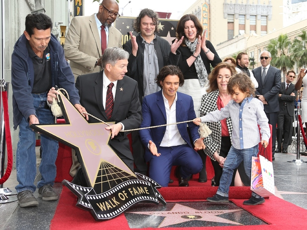 Orlando Bloom and his son Flynn Bloom are honored with a star on the Walk of Fame
