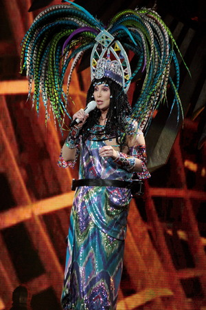 Cher, Cher live in concert in Boston, MA. Caption: 	BOSTON, MA - APRIL 09: Cher performs in concert at TD Garden on April 9, 2014 in Boston, Massachusetts. The legendary performer had her fans rocking and rolling as she put on a great show.