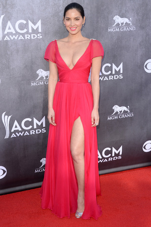 Caption:LAS VEGAS, NV - APRIL 06: Actress Olivia Munn attends the 49th Annual Academy Of Country Music Awards at the MGM Grand Garden Arena on April 6, 2014 in Las Vegas, Nevada. (Photo by Jason Merritt/Getty Images)