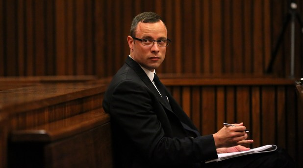 Oscar Pistorius sits in the dock during his trial (25-03-2014)