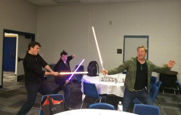 Sean Astin, Alan Tudyk, Nathan Fillion in lightsaber fight