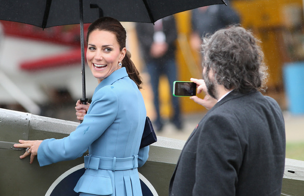 BLENHEIM, NEW ZEALAND - APRIL 10: Catherine, Duchess of Cambridge has her photo taken on an iphone by Sir Peter Jackson during a visit to Omaka Aviation Heritage Centre on Day 4 of a Royal Tour to New Zealand on April 10, 2014 in Blenheim, New Zealand. The Duke and Duchess of Cambridge are on a three-week tour of Australia and New Zealand, the first official trip overseas with their son, Prince George of Cambridge. (Photo by Chris Jackson/Getty Images)