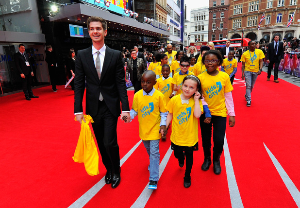 Caption:LONDON, ENGLAND - APRIL 10: Actor Andrew Garfield with children from charity Kids City attend 'The Amazing Spider-Man 2' world premiere at the Odeon Leicester Square on April 10, 2014 in London, England. (Photo by Gareth Cattermole/Getty Images for Sony)