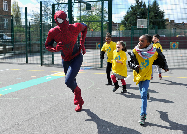 LONDON, ENGLAND - APRIL 08: (EXCLUSIVE COVERAGE) Spider-man actor Andrew Garfield visits local London charity, Kids' City on April 8, 2014 in Brixton, London, England. (Photo by Gareth Cattermole/Getty Images for Sony)