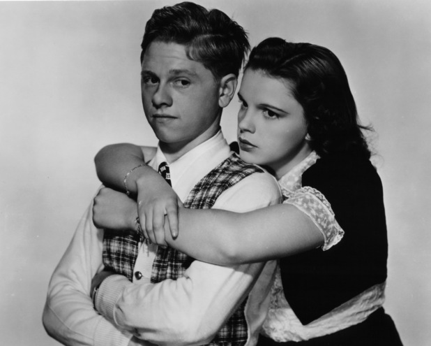 Mickey Rooney is hugged by Judy Garland in a scene from the film 'Love Finds Andy Hardy', 1938.