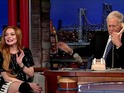 Lindsay Lohan also tears up while being praised by Oprah Winfrey on Late Show.