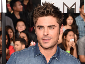 Zac Efron arrives for the MTV Movie Awards 2014