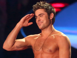Rita Ora rips Zac Efron's shirt off during MTV Movie Awards