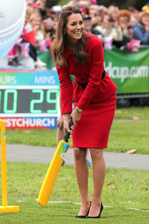 Caption:CHRISTCHURCH, NEW ZEALAND - APRIL 14: Catherine, Duchess of Cambridge plays a game of cricket during a visit to Latimer Square on April 14, 2014 in Christchurch, New Zealand. The Duke and Duchess of Cambridge are on a three-week tour of Australia and New Zealand, the first official trip overseas with their son, Prince George of Cambridge. (Photo by Martin Hunter/Getty Images)