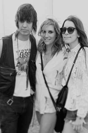 Caption:INDIO, CA - APRIL 12: (EDITORS NOTE: Image was processed using Digital Filters) (L-R) Musicians Julian Casablancas, Kesha and Danielle Haim pose backstage during day 2 of the 2014 Coachella Valley Music & Arts Festival at the Empire Polo Club on April 12, 2014 in Indio, California. (Photo by Jason Kempin/Getty Images for Coachella)