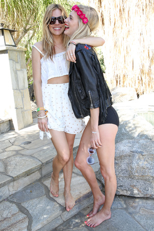 PALM SPRINGS, CA - APRIL 12: Actress Sienna Miller (L) and model Poppy Delevingne attend the Superdry Coachella brunch hosted by Poppy Delevingne on April 12, 2014 in Palm Springs, California. (Photo by Chelsea Lauren/Getty Images for Superdry)