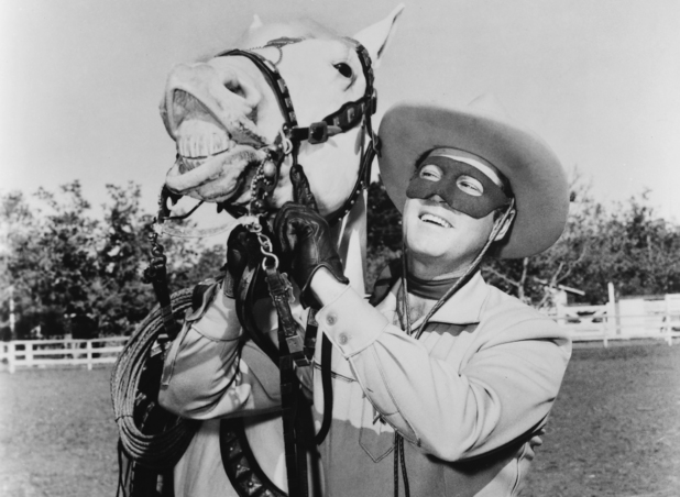 Caption:Clayton Moore (1914-1999), US actor, in costume, holding the reigns of his horse, Silver, in a publicity still issued for the television series, 'The Lone Ranger', USA, circa 1950. The adventure series starred Moore as 'The Lone Ranger'. (Photo by Silver Screen Collection/Getty Images)
