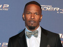 Jamie Foxx says he is spending time with Katie Holmes while working on a project.