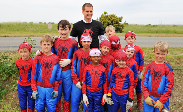 Andrew Garfield poses with kid volunteers in a 'Be Amazing' volunteer habitat restoration project