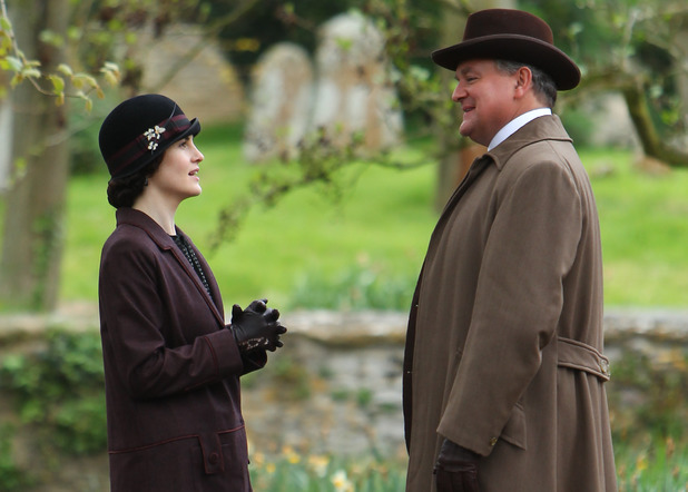 The cast of Downton Abbey film scenes on location outside a churchyard Hugh Bonneville, Michelle Dockery