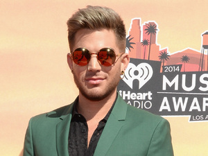 LOS ANGELES, CA - MAY 01: iHEARTRADIO MUSIC AWARDS -- Pictured: Singer Adam Lambert arrives at the iHeartRadio Music Awards held at the Shrine Auditorium on May 1, 2014. (Photo by Larry Busacca/NBC/NBCU Photo Bank)