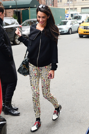 NEW YORK, NY - MARCH 19: Amal Alamuddin is seen outside her hotel on March 19, 2014 in New York City. (Photo by Raymond Hall/GC Images)