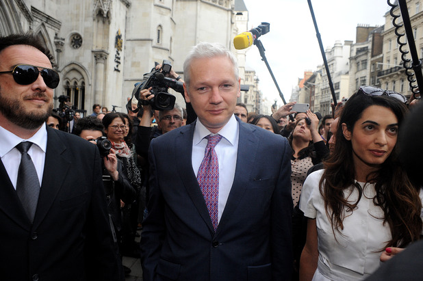 Wikileaks Founder Julian Assange, C, Leaves Britain's Royal Courts Of Justice with lawyer Amal Alamuddin After His Extradition Appeal Was Heard In Central London, Wednesday, July 13, 2011. Assange Is Fighting Extradition To Sweden On The Grounds That The Allegations Of Sexual Misconduct Laid Against Him There Don'T Amount To A Crime. Assange'S Repeated Disclosures Of Classified U.S. Documents Have Infuriated The Pentagon And Energized Critics Of American Foreign Policy, But Allegations That The 40-Year-Old Australian Molested Two Women During A Trip To Scandinavia Last Year Have Tarnished His Reputation And Cast A Shadow Over His Future. (Photo by John Phillips/UK Press via Getty