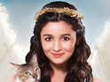 Bhatt is dressed as an angel in the ad which encourages people to adopt pets.