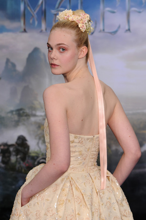 LONDON, ENGLAND - MAY 08: Elle Fanning attends a private reception as costumes and props from Disney's 'Maleficent' are exhibited in support of Great Ormond Street Hospital at Kensington Palace on May 8, 2014 in London, England. (Photo by Eamonn M. McCormack/Getty Images)