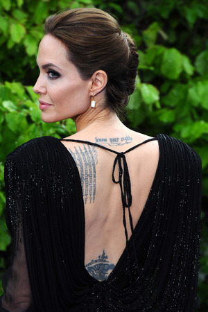 LONDON, ENGLAND - MAY 08: Angelina Jolie attends a private reception as costumes and props from Disney's 'Maleficent' are exhibited in support of Great Ormond Street Hospital at Kensington Palace on May 8, 2014 in London, England. (Photo by Anthony Harvey/Getty Images)