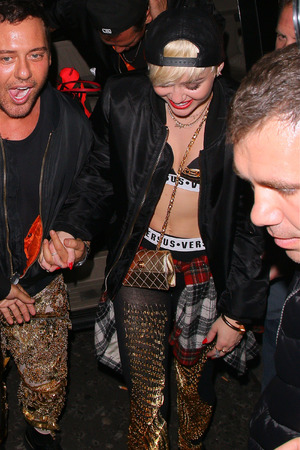 LONDON, UNITED KINGDOM - MAY 08: Miley Cyrus at Madame Jojo's Night and Cabaret Club on May 8, 2014 in London, England. (Photo by Mark Robert Milan/GC Images)