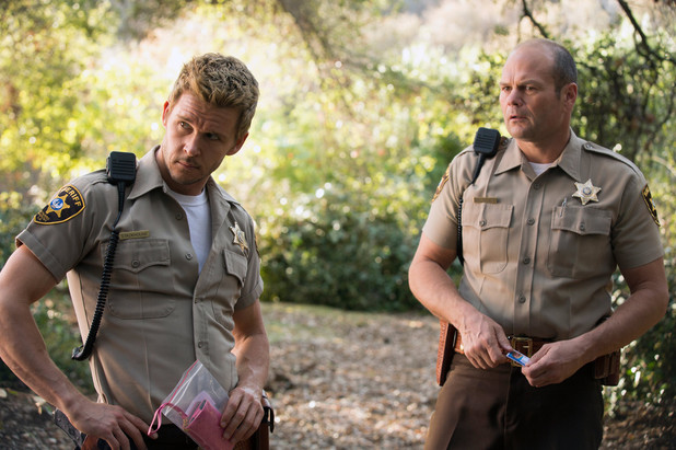 Ryan Kwanten as Jason Stackhouse and Chris Bauer as Andy Bellefleur in True Blood Season 7
