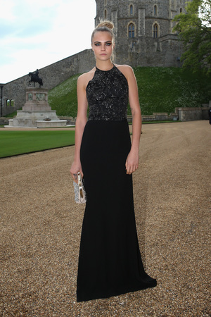 WINDSOR, ENGLAND - MAY 13: Cara Delevingne arrives for a dinner to celebrate the work of The Royal Marsden hosted by the Duke of Cambridge at Windsor Castle on May 13, 2014 in Windsor, England. (Photo by Chris Jackson/Getty Images)